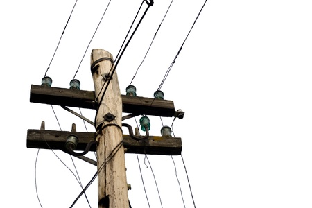 Top of an old-fashionded wood pylon with muddled wires in front of a white background