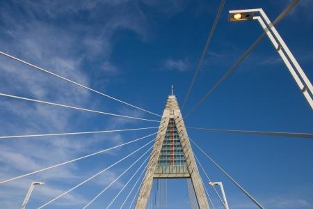 megyeri: A pylon of Bridge Megyeri  with  wire-ropes and three lampposts.