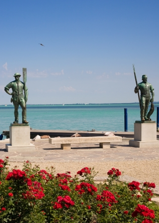 Statues of fisherman and boatman at the beach of Balatonfured, Hungary. Stock Photo
