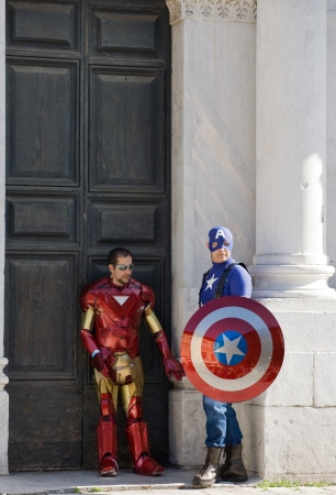 LUCCA - OCTOBER 31  Superheroes standing in front of the Cathedral Editorial