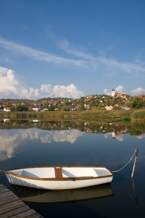 A view of Tihany with a white boat in front from the inner lake, near to lake Balaton, Hungary.