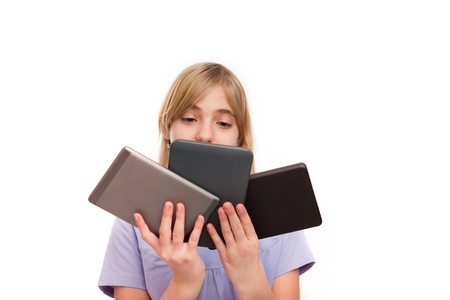 Ebook readers and tablets - Young girl holding different types of ebook readers and tablets  Isolated on white