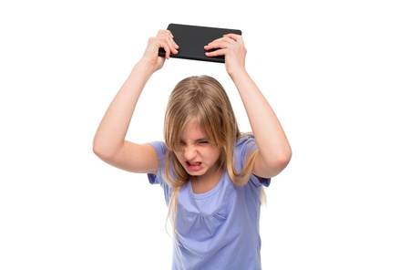 pissed off: Angry teen girl pissed off with her tablet so she flooring it  Isolated on white