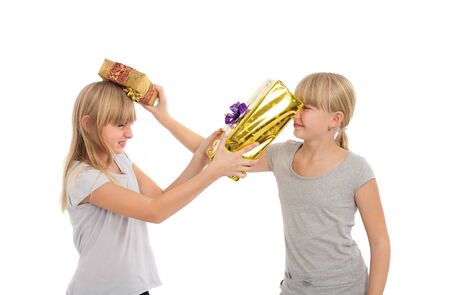 Sisters beating each other with gift boxes