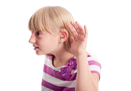 What? - Young female wearing hearing aid cant hear you photo