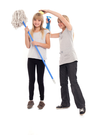 Funny teen girls playing with cleaning utensils photo