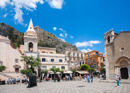 TAORMINA, ITALY - MAY 11, 2012  Taormina town main square center with the Chiesa Di San Giuseppe temple in Sicily Italy Editorial
