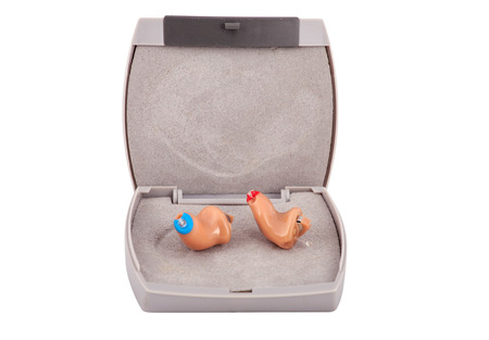 completely: CIC (completely in the ear) Hearing aids with box .Isolated on white. Stock Photo
