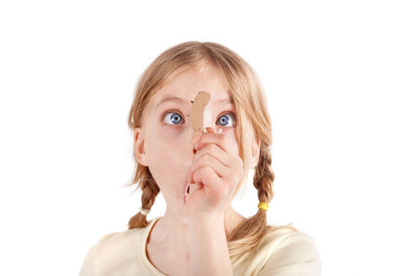 Cute girl looking at a hearing aid with wide eyes photo