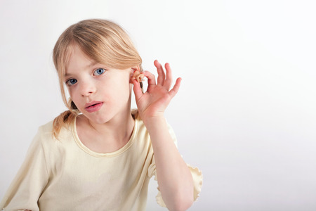 deafness: Small girl trying a CIC hearing aid