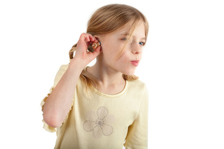 Cute girl trying  a CIC (Completely in the Ear) hearing aid