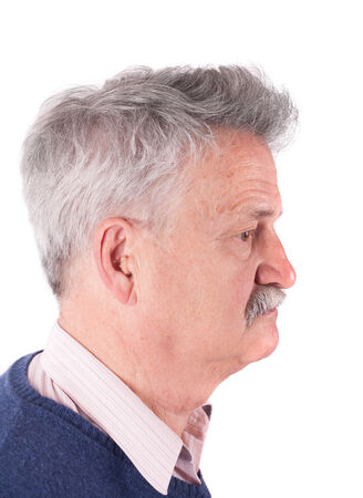 Portrait of an Senior man wearing CIC (Completely In The Canal) hearing aids Stock Photo - 27462849