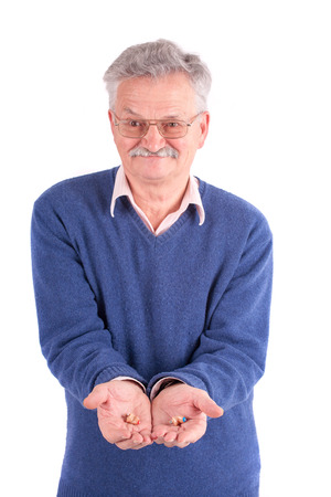 Senior man showing his CIC (completely in canal) hearing aids photo