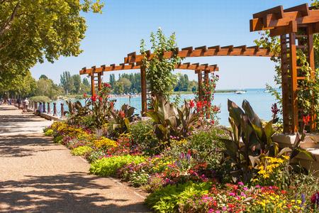 tagore: Flower garden at Lake Balatons beach in Balatonfured, Hugary Editorial