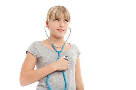 self exam: Girl checking herself with a stethoscope
