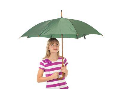 Beautiful young girl holding a green umbrella.  Stock Photo