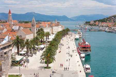 velo: TROGIR, CROATIA - JUNE 19, 2014: The Old Town of Trogir with tourist boats in Croatia. UNESCO World heritage place