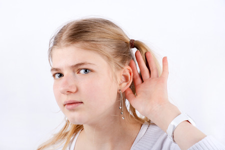 cant: Portrait of a beautiful Girl who cant hear well Stock Photo