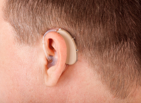 Close up of a mans ear with hearing aid