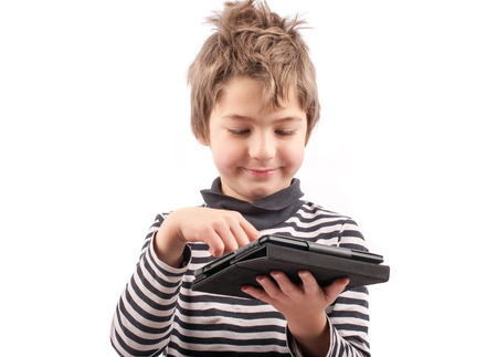 Geek kid happy his tablet device. Isolated on white. photo