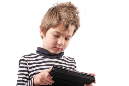 Geek kid addicted to his tablet device. Isolated on white. photo