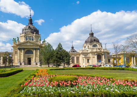 szechenyi: The Szechenyi Bath in Budapest, Hungary with a flower garden in the front. Editorial