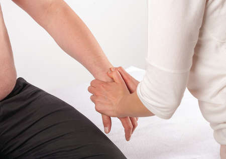alternative practitioner: Bowen therapy - treatment of a mans hand Stock Photo
