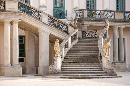 banister: Old stone stairway of Esterhazy Castle with wrought iron banister and statues in Fertod, Hungary
