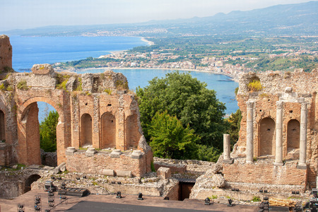 The ancient -roman-greek amphitheatre with the Giardini Naxos bay in the back in Taormina city, Sicily, Italy Stok Fotoğraf