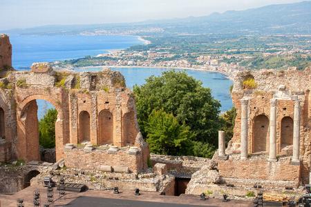 The ancient -roman-greek amphitheatre with the Giardini Naxos bay in the back in Taormina city, Sicily, Italy Stock Photo