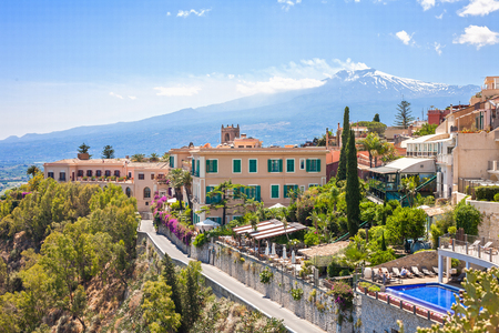 int: View of Taormina with Etna volcano int the back in Sicily, Italy