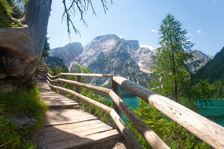 sudtirol: Hiking trail at Lake Braies in the Dolomites with the Seekofel mountain in the background, Sudtirol,Italy Stock Photo