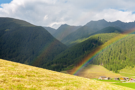 sudtirol: Beautiful landscape from the Dolomites with double rainbow in Italy, Sudtirol