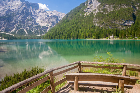 sudtirol: Lake Braies in the Dolomites with a wooden bench in the front and the Seekofel mountain in the background in  Sudtirol,Italy