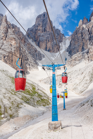 abrupt: Colorful cable car leading to Forcella Staunies, in the Mount Cristallo massif (Cortina dAmpezzo, Dolomites, Italy