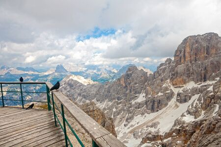 sudtirol: Panoramic view of Mountain peaks from the Forcella Staunies with some jacdaws in the Dolomites (Italy, Sudtirol)