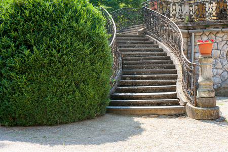 banister: Stairway of a baroque palace with wrought iron banister in a park