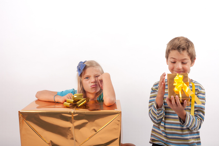 pessimist: Optimist brother and pessimist sister - the brother is happy with a smaller gift box than his sister with a big one so she is very upset