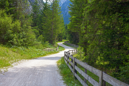 sudtirol: Hiking and biking trail at Lake Dobbiaco in the Dolomites , Sudtirol,Italy
