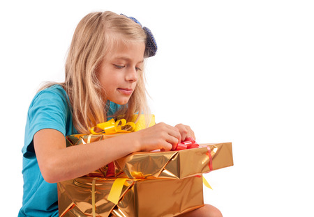 unwrapping: Cute girl opening her present box excitedly