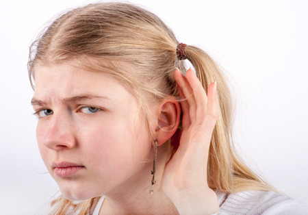 cant: Young girl cant hear you - she cupping her hand behind her ear and looking very sadly