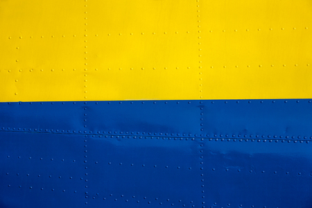 constructional: Yellow-blue riveted steel constructional close up (aeroplane) Stock Photo