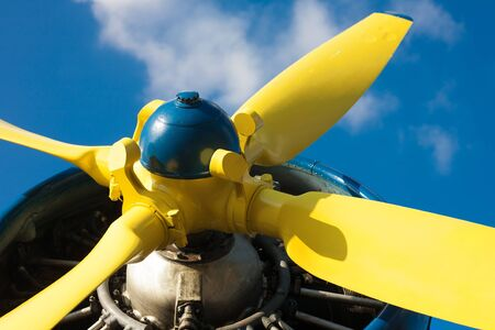 YELLOW: Detail of an old airplane's yellow propeller
