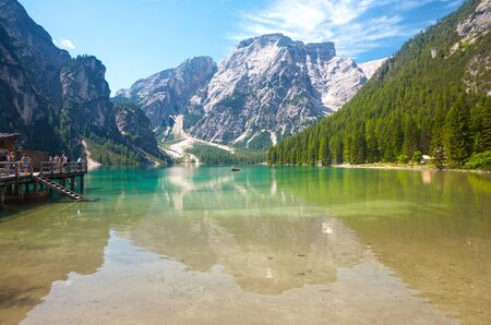 sudtirol: LAKE BRAIES, ITALY - JUL 03, 2015: Lake Braies in the Dolomites with the Seekofel mountain in the background, Sudtirol,Italy Stock Photo