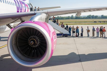turbojet: Budapest, Hungary - May 29, 2015: People boarding a Wizzair airplane. Wizzair is one of the largest budget airline in Europe. Editorial