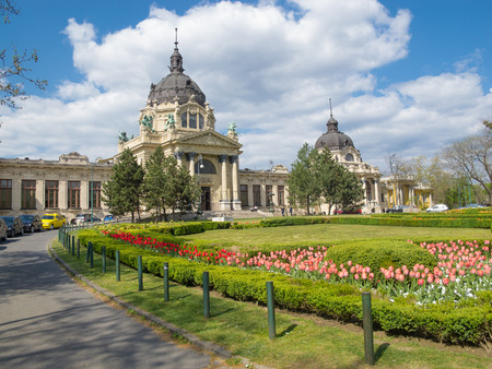 szechenyi: BUDAPEST, HUNGARY - APRIL 19, 2015: The Szechenyi Bath in Budapest, Hungary with a flower garden in the front.
