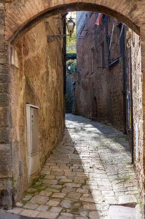 volterra: Narrow street in Volterra, Tuscany