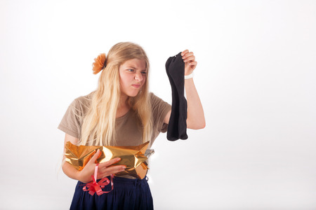 Girl not too happy with her gift which is a pair of socks