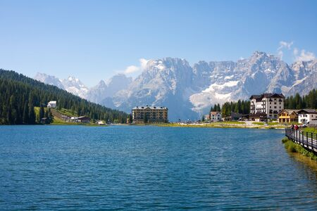 lake misurina: Lake Misurina with tourist complexums in the Dolomites in Italy Stock Photo
