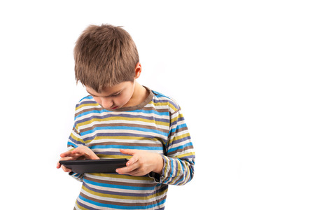 android tablet: Geek kid using a touch pad device Stock Photo